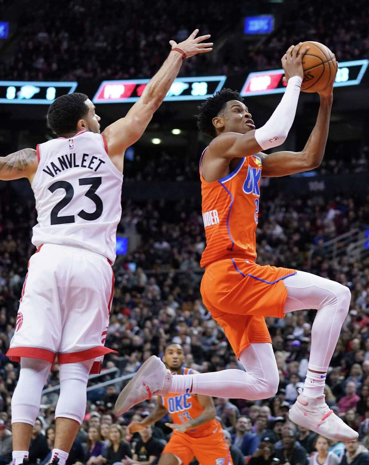 Oklahoma City Thunder Shai Gilgeous-Alexander (2) drives to the basket against the defence of Toronto Raptors Fred VanVleet (23) during fourth quarter NBA basketball action in Toronto on Sunday, Dec. 29, 2019. (Hans Deryk/The Canadian Press via AP)