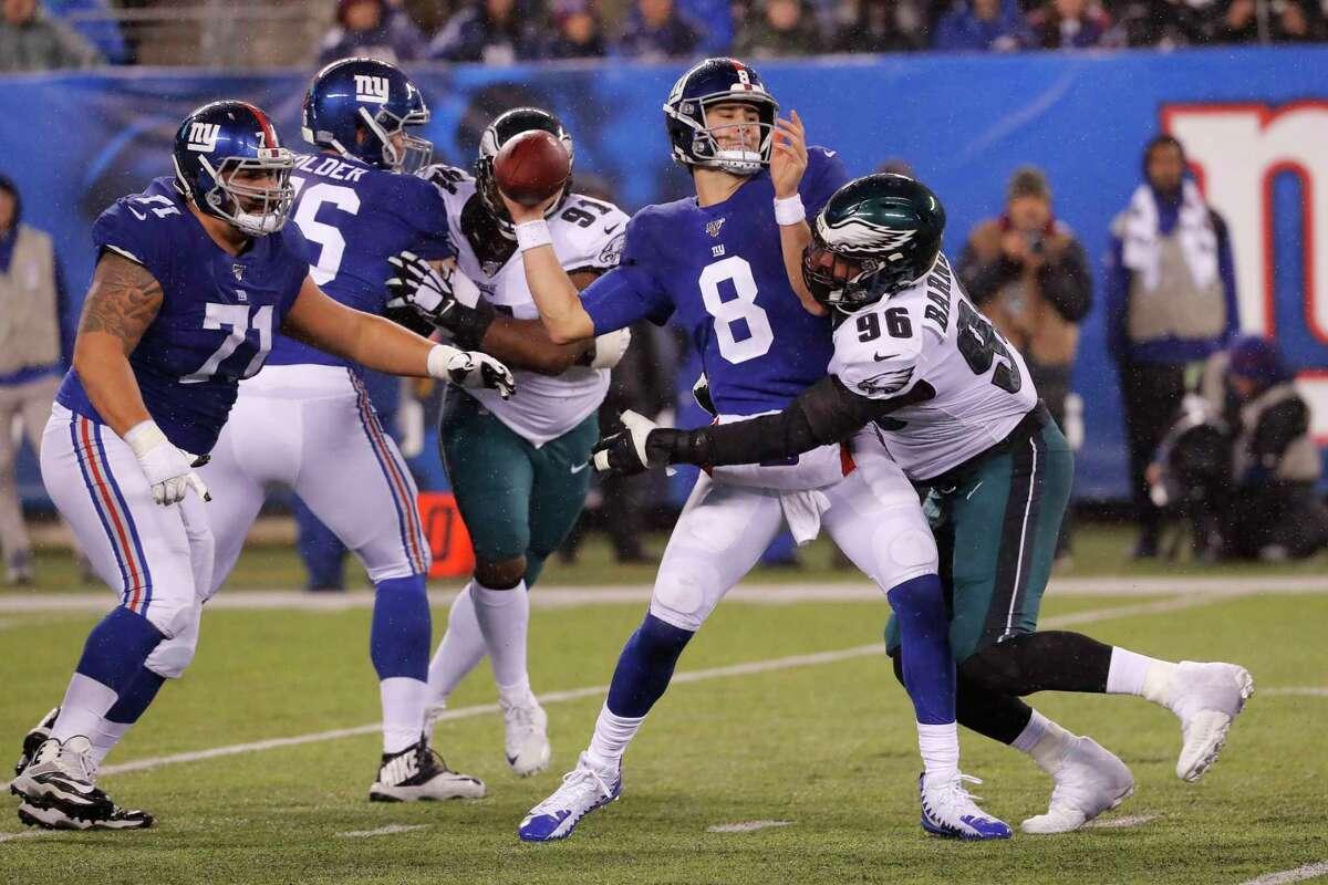 New York Giants quarterback Daniel Jones (8) looks to pass as he is sacked by Philadelphia Eagles defensive end Derek Barnett (96) in the second half of an NFL football game, Sunday, Dec. 29, 2019, in East Rutherford, N.J. (AP Photo/Seth Wenig)