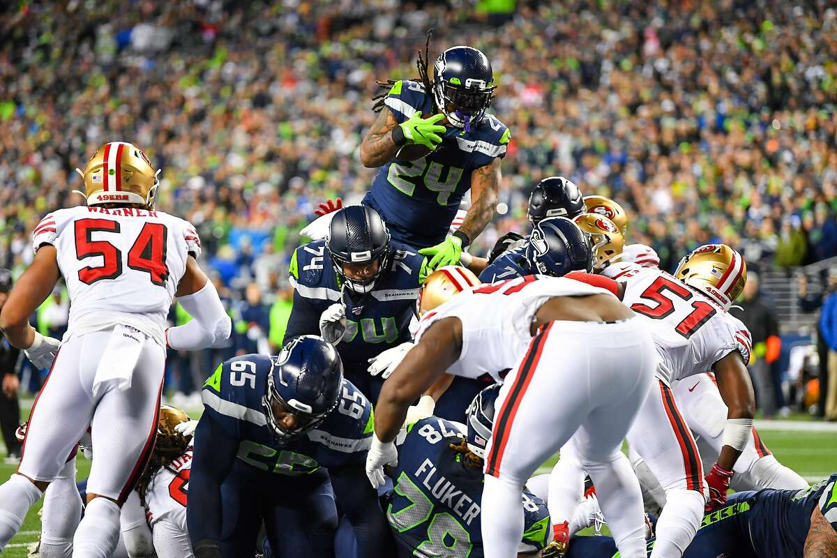 Marshawn Lynch #24 of the Seattle Seahawks leaps and scores during the during the fourth quarter of the game against the San Francisco 49ers at CenturyLink Field on December 29, 2019 in Seattle, Washington.