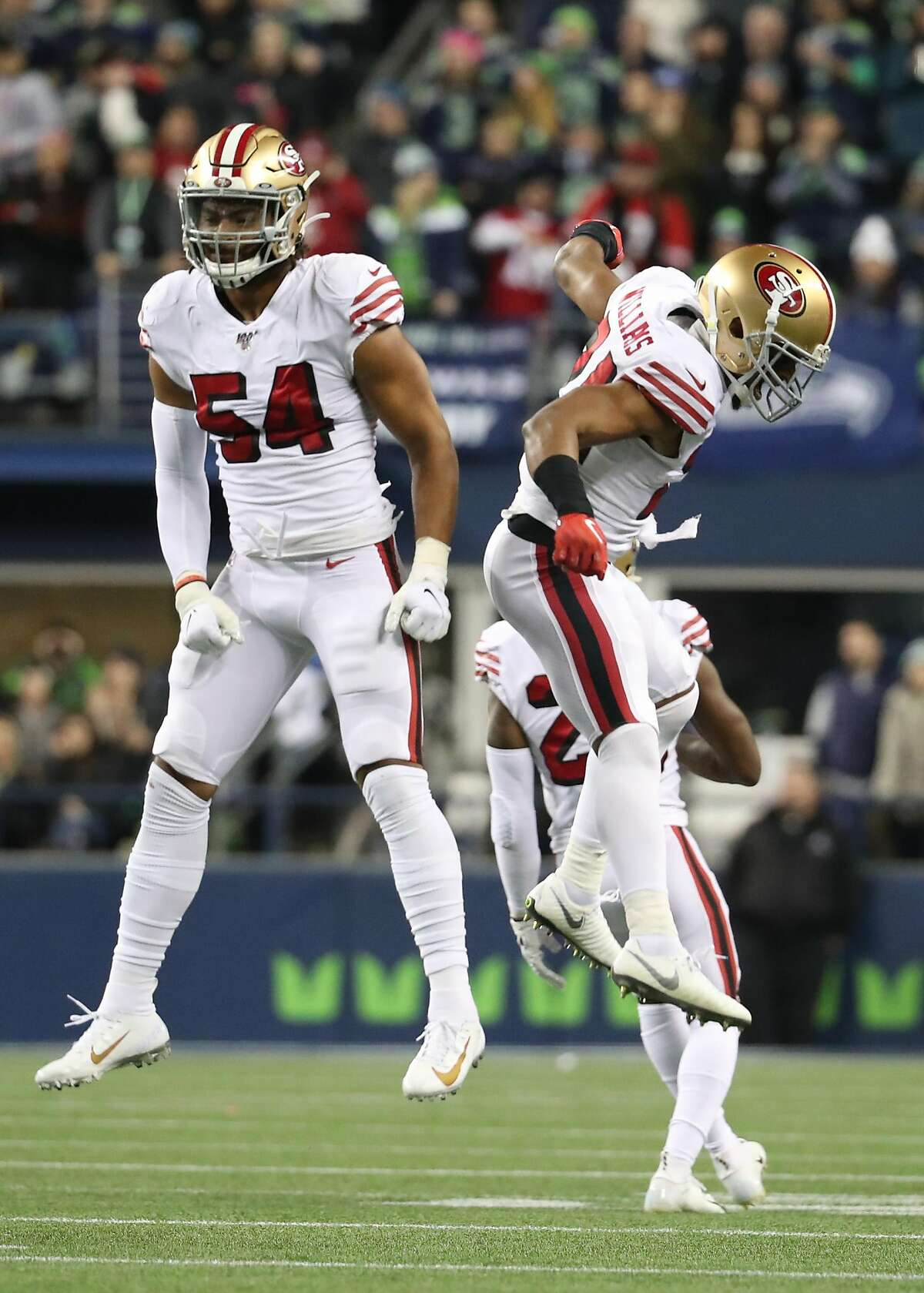 Middle linebacker Fred Warner #54 of the San Francisco 49ers and defensive back K'Waun Williams #24 celebrate a play against the Seattle Seahawks during the second quarter of the game at CenturyLink Field on December 29, 2019 in Seattle, Washington.