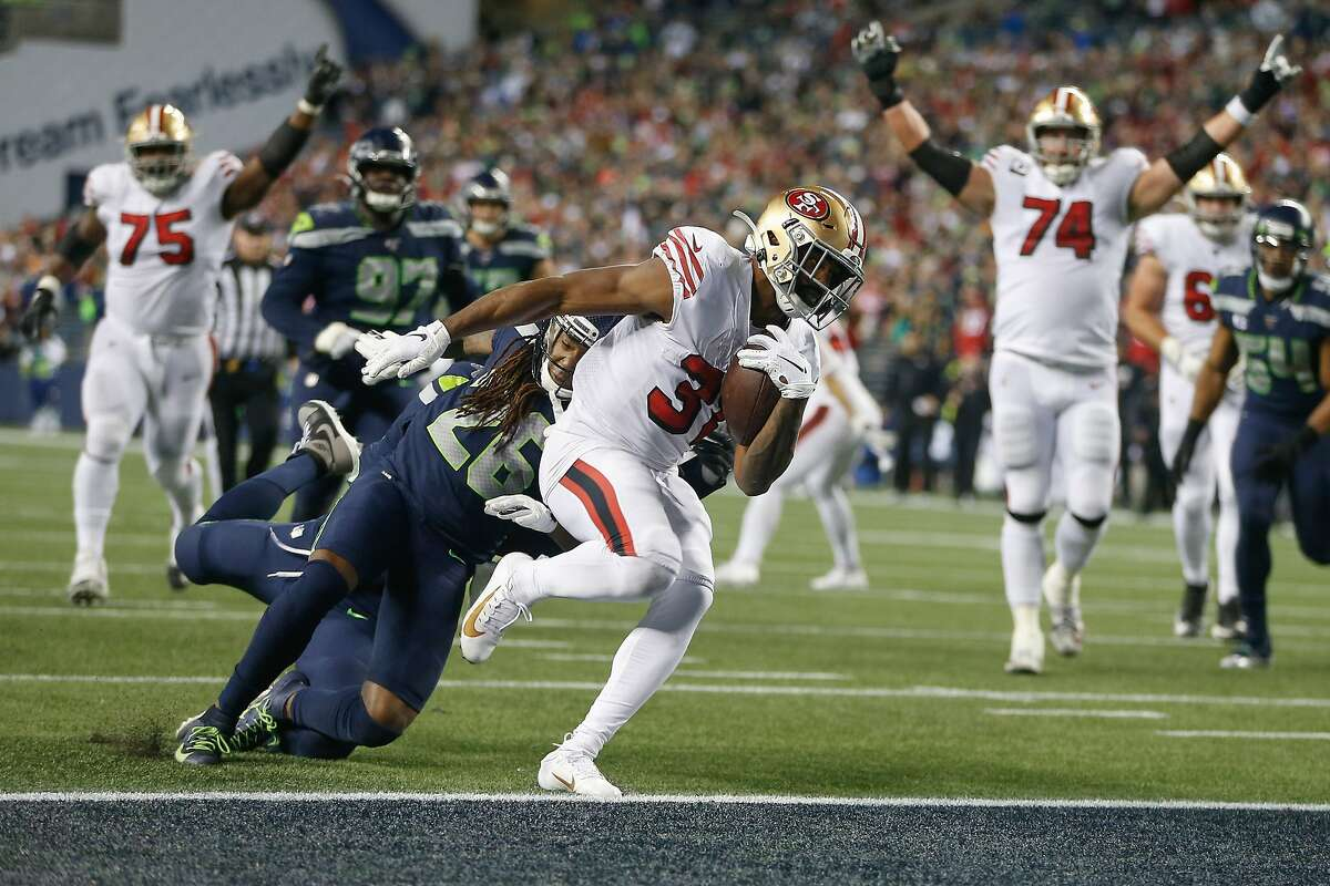 Running back Raheem Mostert #31 of the San Francisco 49ers scores a touchdown in the fourth quarter against the Seattle Seahawks at CenturyLink Field on December 29, 2019 in Seattle, Washington.