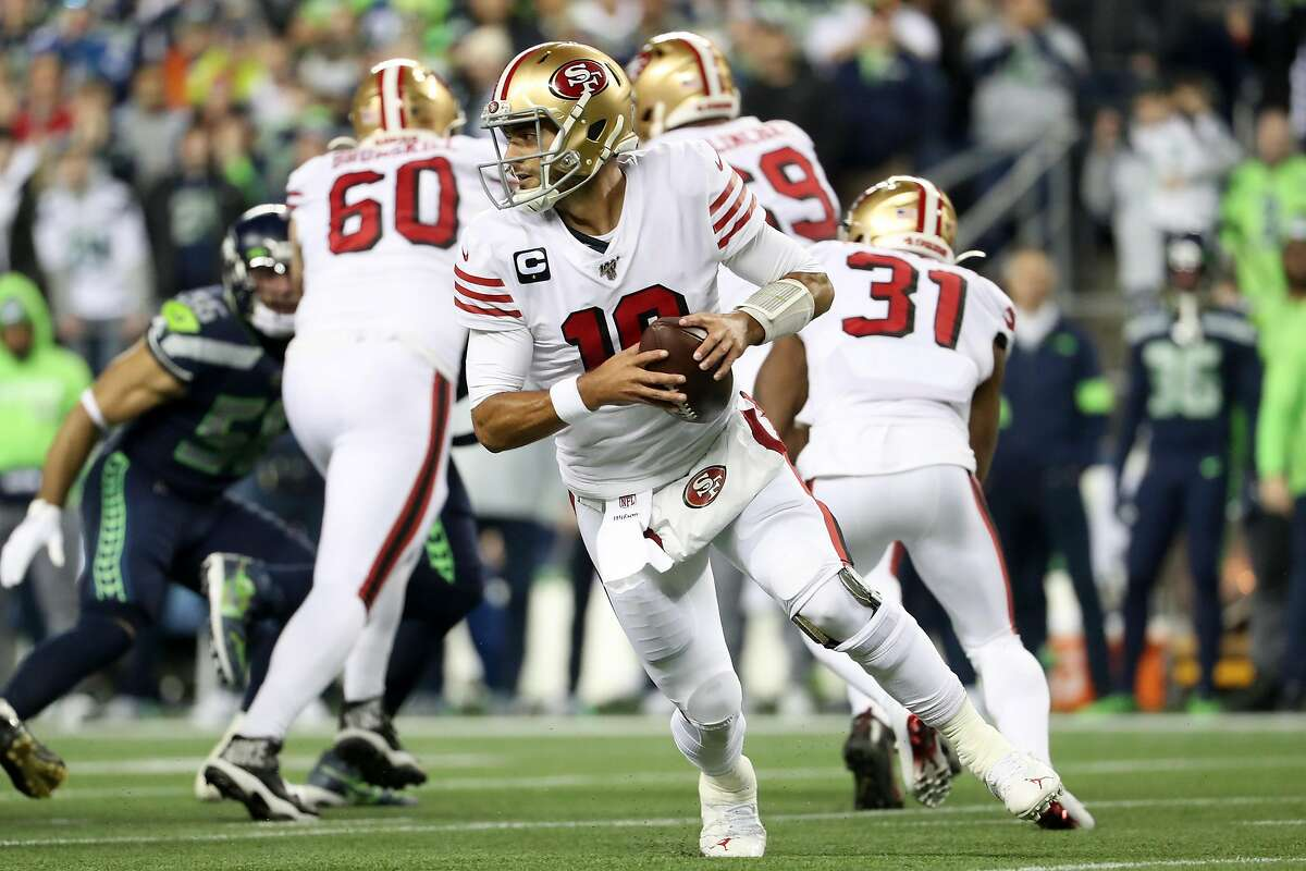 Quarterback Jimmy Garoppolo #10 of the San Francisco 49ers looks to pass against the Seattle Seahawks during the first quarter of the game at CenturyLink Field on December 29, 2019 in Seattle, Washington.