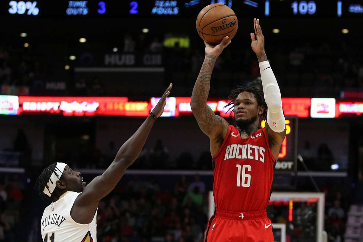 NEW ORLEANS, LOUISIANA - DECEMBER 29: Ben McLemore #16 of the Houston Rockets shoots the ball over Jrue Holiday #11 of the New Orleans Pelicans at Smoothie King Center on December 29, 2019 in New Orleans, Louisiana. NOTE TO USER: User expressly acknowledges and agrees that, by downloading and/or using this photograph, user is consenting to the terms and conditions of the Getty Images License Agreement. (Photo by Chris Graythen/Getty Images)