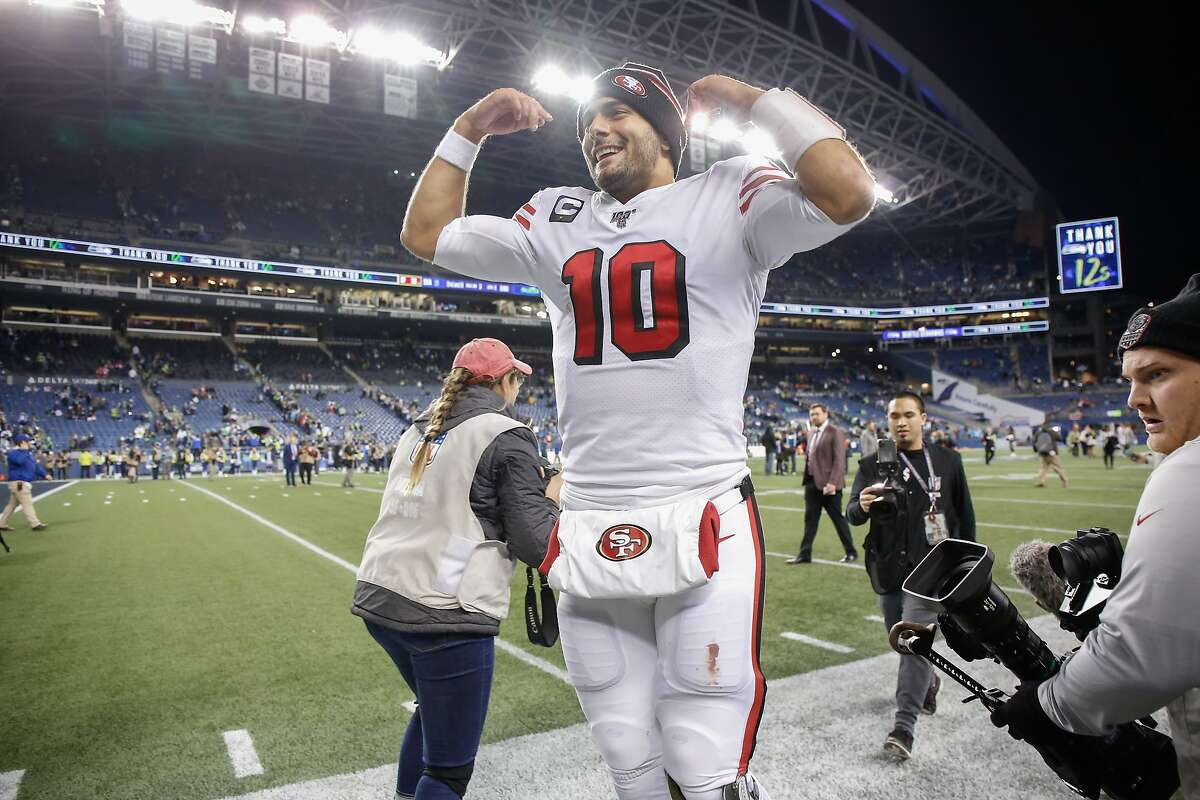 SEATTLE, WA - DECEMBER 29: Quarterback Jimmy Garoppolo #10 of the San Francisco 49ers heads off the field following the game against the Seattle Seahawks at CenturyLink Field on December 29, 2019 in Seattle, Washington. (Photo by Otto Greule Jr/Getty Images)