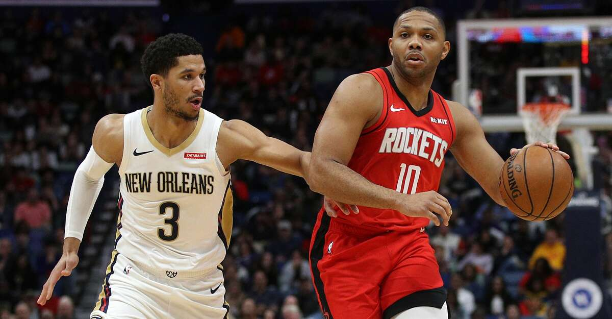 NEW ORLEANS, LOUISIANA - DECEMBER 29: Eric Gordon #10 of the Houston Rockets drives the ball around Josh Hart #3 of the New Orleans Pelicans at Smoothie King Center on December 29, 2019 in New Orleans, Louisiana.