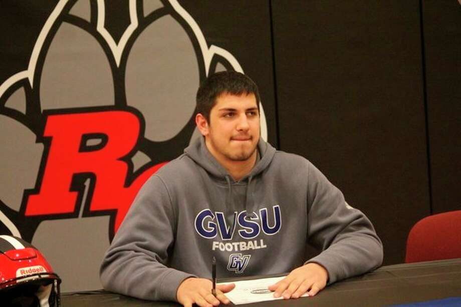 Anthony Pelton is pictured here on signing day when he formally committed last February to Grand Valley football. (Pioneer file photo)