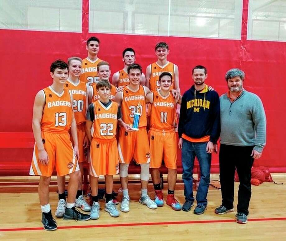 The Big Rapids Badgers: front row, left to right, Lance Ketelaar, Jacob Plaggemars, Ryan Jensen, Trent Fetterley, assistant coach Richard Cargill and head coach Wayne Kauffman;secondrow, Joshua Plaggemars, Kyle Ruiter, Joshua Kauffman and Micheal Cargill. Third row Tanner Fetterley. Missing in photoare Daniel Thompson, Micaiah Ford and Samuel Couturior. (Courtesy photo)