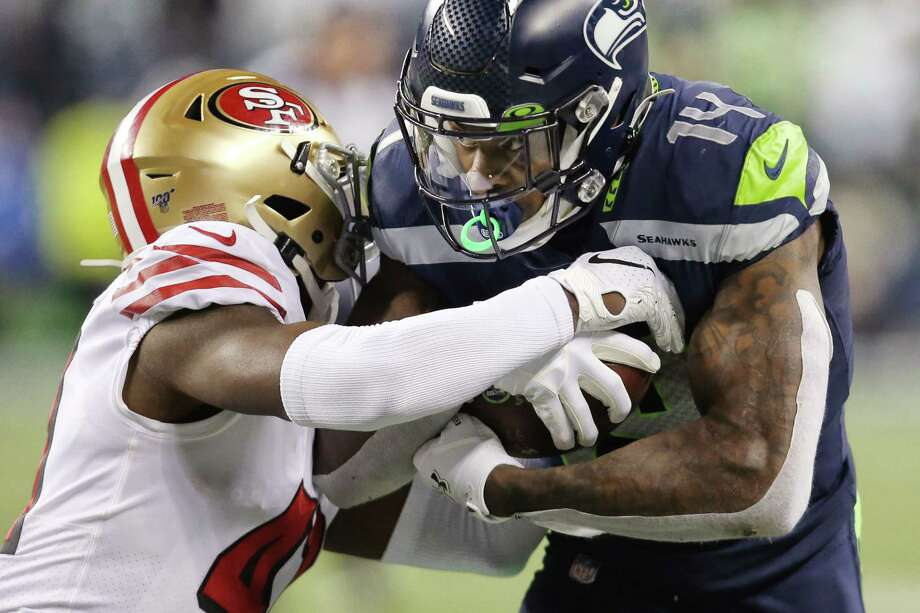 Seattle Seahawks wide receiver D.K. Metcalf (14) picks up 24 yards in the fourth quarter of Seattle's game against San Francisco, Sunday, Dec. 29, 2019 at CenturyLink Field. Photo: Genna Martin, Seattlepi.com / GENNA MARTIN