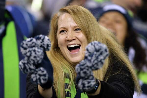 Fans react in the fourth quarter of Seattle's game against San Francisco, Sunday, Dec. 29, 2019 at CenturyLink Field.