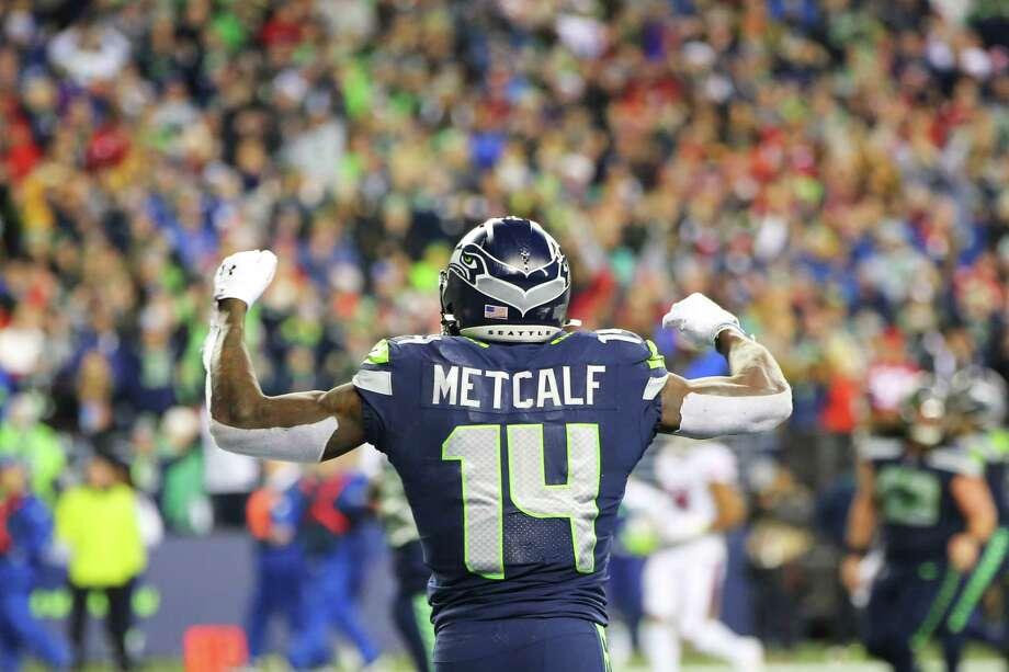 Seattle Seahawks wide receiver D.K. Metcalf (14) celebrates his fourth quarter touchdown. Photo: Genna Martin, Seattlepi.com / GENNA MARTIN