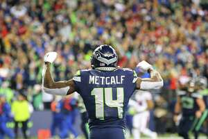 Seattle Seahawks wide receiver D.K. Metcalf (14) celebrates his fourth quarter touchdown.