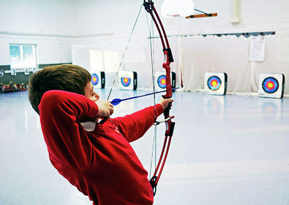 Northeast Elementary Magnet School student Zane Flessner takes aim at a target during archery practice in Danville. Photo: Carol Roehm | Commercial-News (AP)