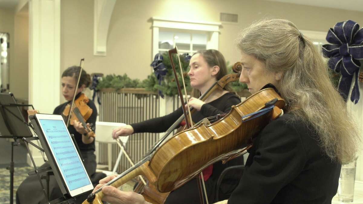 A three-string quartet entertains those attending the party.