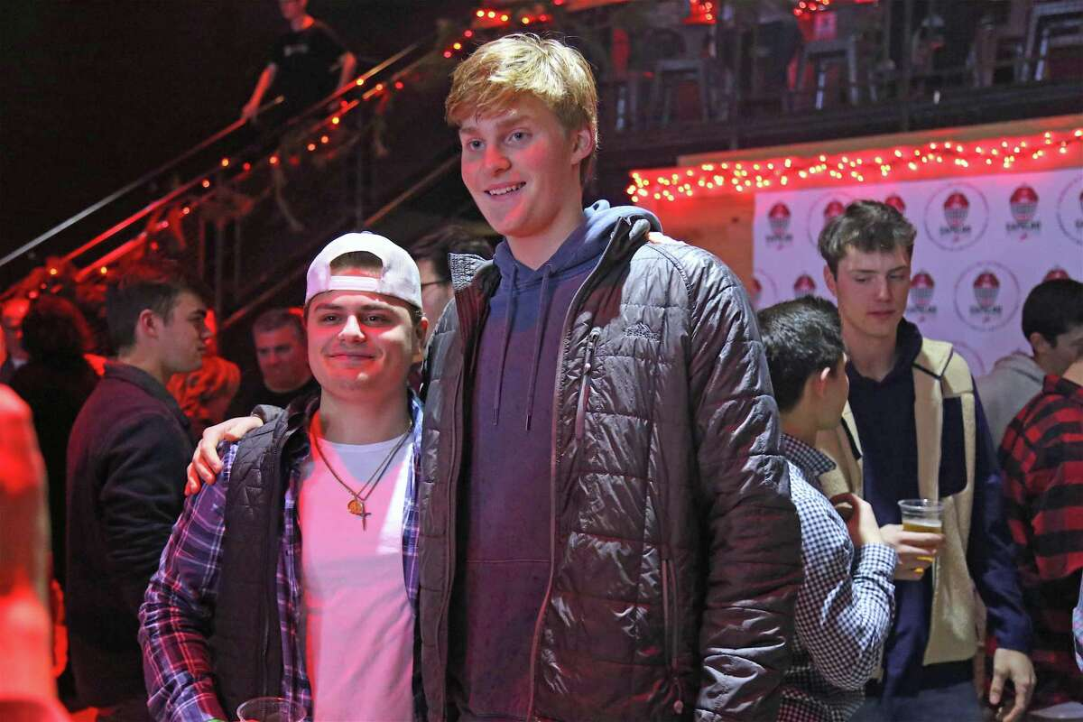 Will Capalbo, left, gets a picture with Aidan Harding of Fairfield at the Capalbo Strong Crushed Cancer Event at the Fairfield Theatre Company on Sunday, Dec. 29, 2019, in Fairfield, Conn.