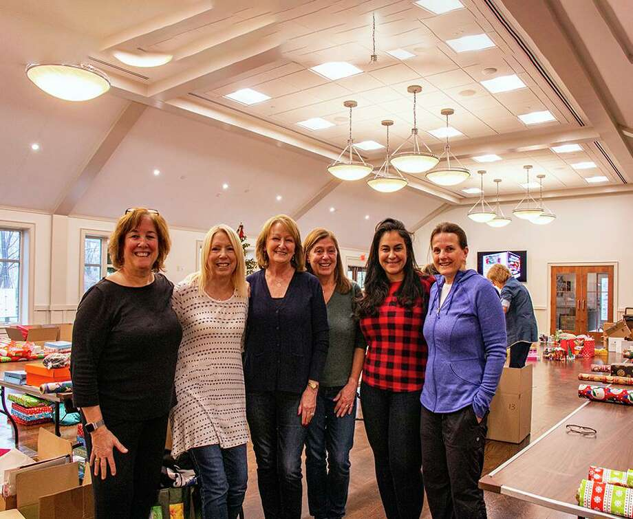 Ridgefield Thrift Shop board member Mary Coleman, center, stands with committee members from the Evelyn C. Peeler Children's Holiday Gift Fund. From left to right: Sue Ferguson, Denise Brown, Kristi Vaughn, Gigi Bazarian and Joann Mulvaney. Photo: Sue Ferguson / Contributed Photo