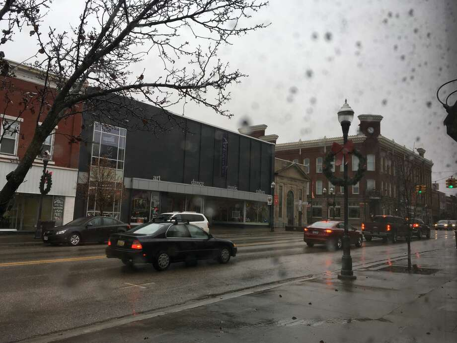 Cloudy, gray skies and rain could be seen on Michigan Avenue in Big Rapids Monday morning. By nightfall, according to the National Weather Service, that rain could be turned to snow - several inches of snow. Photo: Pioneer Photo/Tim Rath