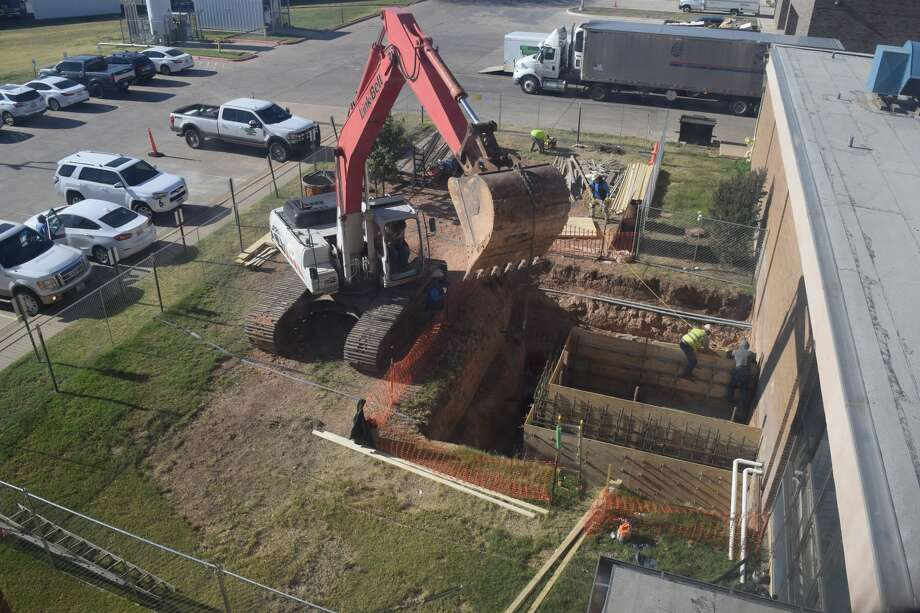 Construction crews excavate at 20-foot hole on the east side of Covenant Health Plainview in order to construct a ramp to access the basement. Crews are also working on patient floors which kick off new phases of the hospital's $40 million renovation. Photo: Courtesy Photo