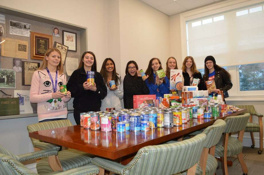 "Members from from Ridgefield High School's Interact Club made a large donation to RVNAhealth's food pantry before the holidays. The pantry is open Monday through Friday between the hours of 8:30 a.m. and 4:30 p.m. ""Nutritious food helps homebound and in-need patients heal faster,"" RVNAhealth wrote on its Twitter page. ""A huge thanks to the Ridgefield High School Interact Club for contributing a bounty of donations to our food pantry!"" Photo: Contributed Photo"