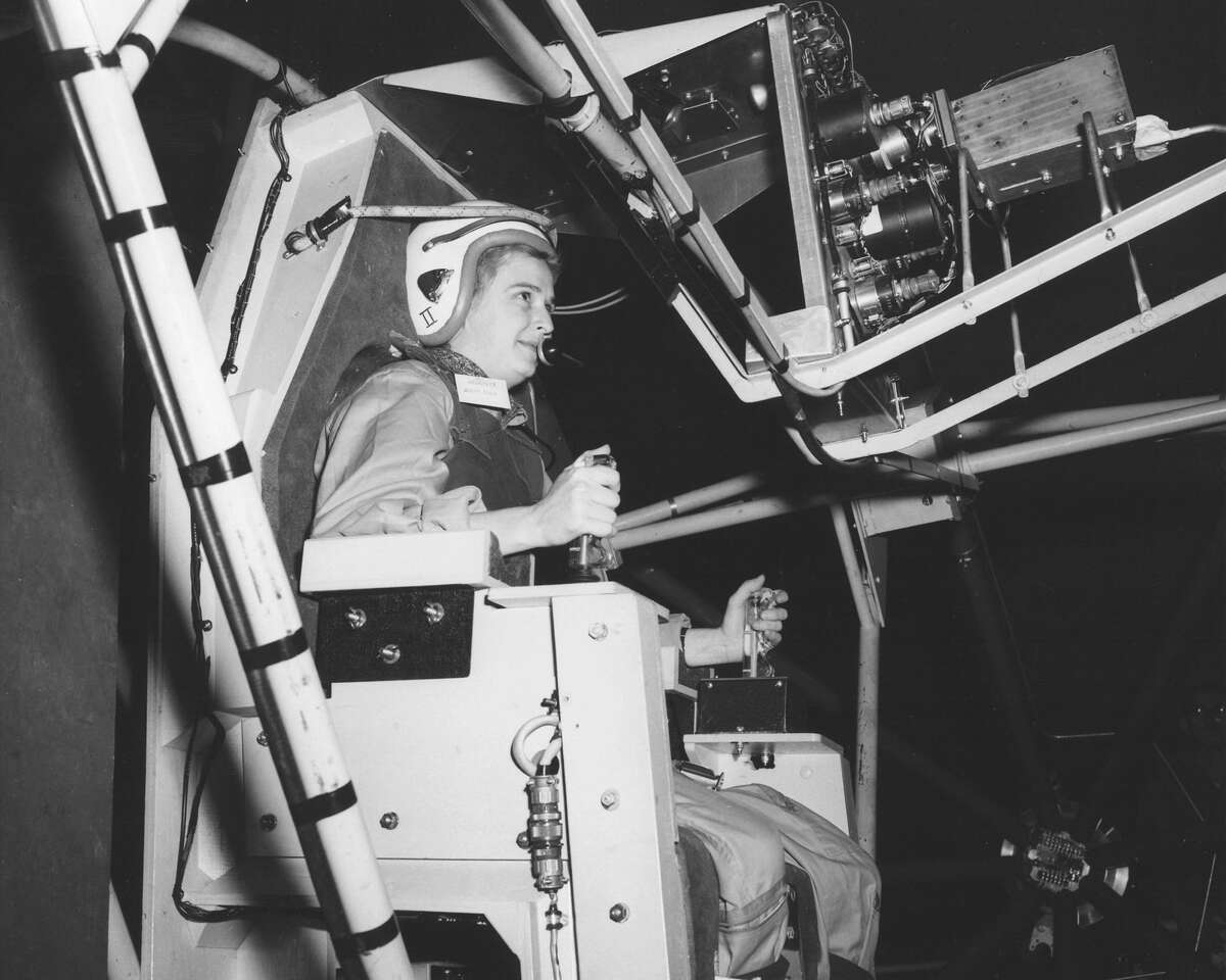 Jerrie Cobb, a well-known female pilot in the 1950s, flies the Gimbal Rig in the Altitude Wind Tunnel, (AWT) in April 1960 at the Lewis Research Center (now Glenn Research Center). The Gimbal Rig, formally called MASTIF or Multiple Axis Space Test Inertia Facility, was used to train astronauts to control the spin of a tumbling spacecraft. As part of a privately funded initiative Jerrie Cobb was the first woman to pass all three phases of the Mercury astronaut screening program. However, U.S. Government policy at the time stipulated a number of very specific qualifications for becoming an astronaut, including experience as a military test pilots. So, although the women who had volunteered for this private initiative did as well, or better, on the various screening tests than the original seven astronauts, the effort collapsed when it became clear that the government was not going to overturn the existing list of qualifications to admit any of the women into the astronaut corps.