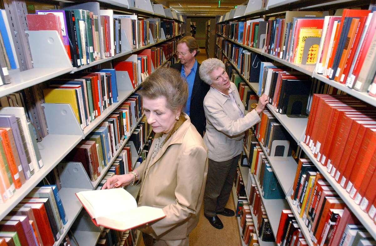 Members of the Saratoga Reads! committee from front to back are Florence Andresen, Jacki Jung and Kevin Richardson who review books to be considered for the project at the library at Skidmore College. (James Goolsby)