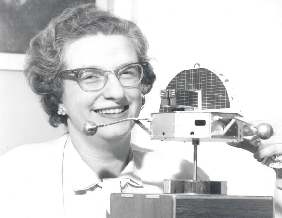 (1962) Dr. Nancy Roman, one of the nations top scientists in the space program, is shown with a model of the Orbiting Solar Observatory (OSO).