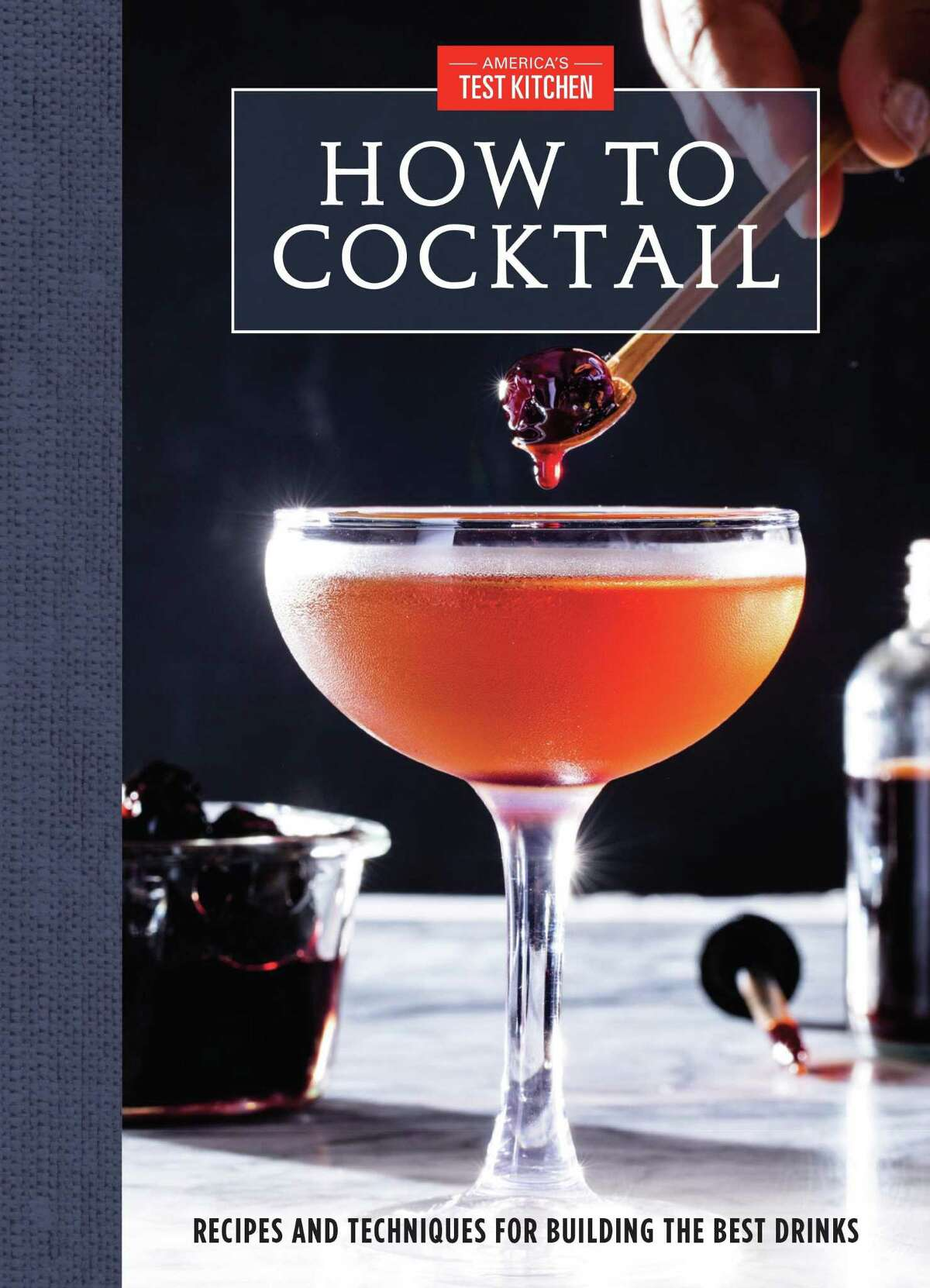 """""""How to Cocktail: Recipes and Techniques for Building the best drinks,"""" by the editors of America's Test Kitchen (2019, $24.99)"""
