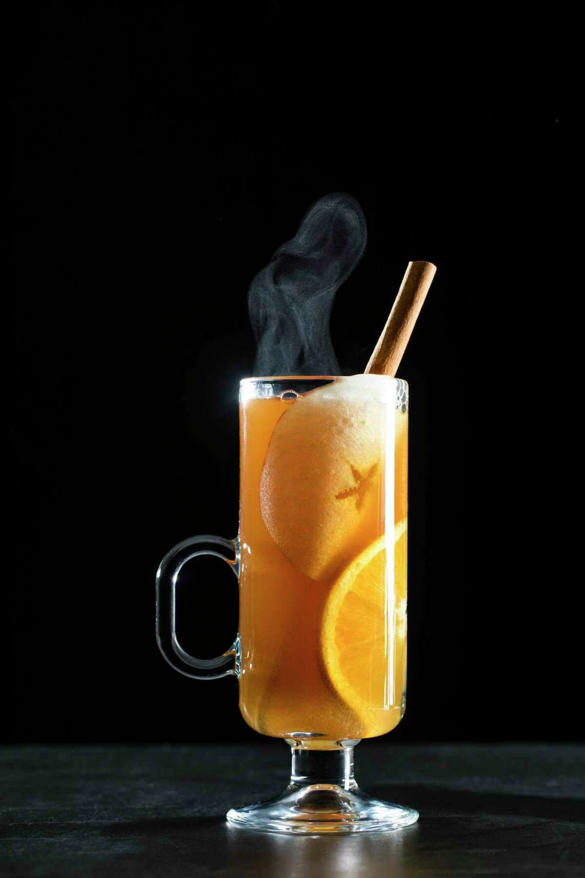 Brandied Mulled Cider. Bubbling away on the stovetop, mulled cider has a fantastic aroma. (recipe in column)