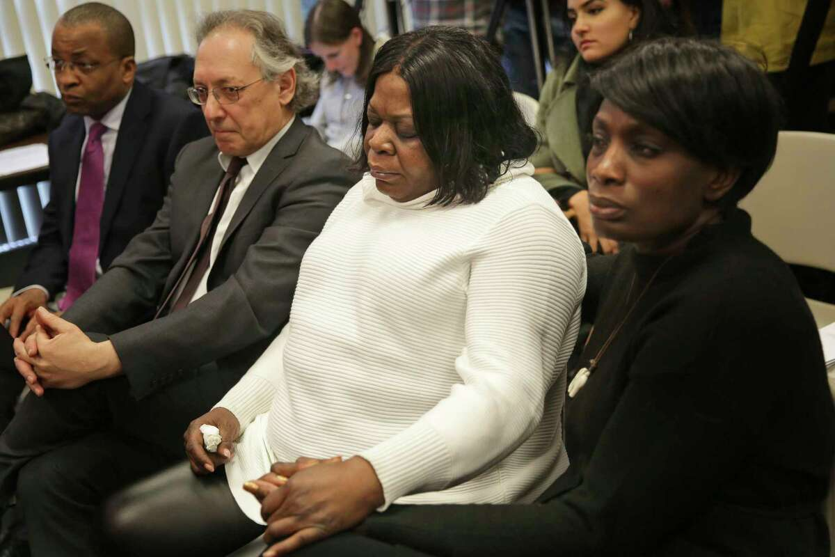 Kim Thomas, center, mother of Grafton Thomas, the man accused of stabbing multiple people at a Hanukkah celebration, sits with Rev. Wendy Paige, right, and attorney Michael Sussman, left, who is representing her son, at a news conference in New City, N.Y., Monday, Dec. 30, 2019.
