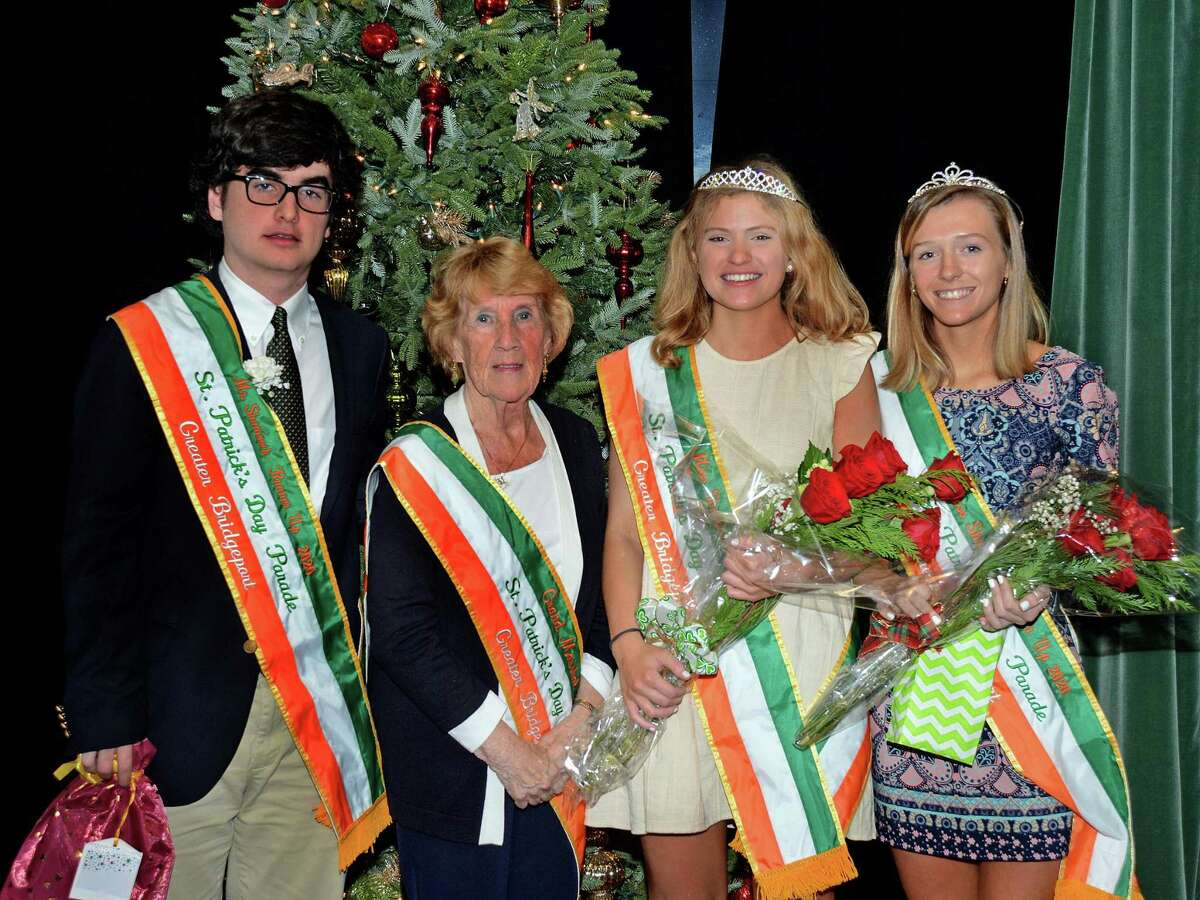From left, Mr. Shamrock runner-up Jack Clyne, Parade Grand Marshal Mary Ann Doonan, Miss Shamrock Mary Feeney and Miss Shamrock runner-up Bridget Keary at a recent ceremony at the Gaelic American Club. Mr. Shamrock Seamus Carolan was absent from the photo due to being at a game with his hockey team.