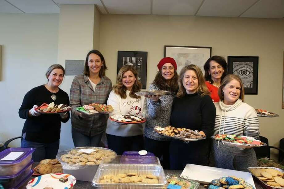 The St. Luke's Parents' Association Cookie Stroll committee poses for a photo at the event, which took place in the school's Forese Family Fireplace Commons Dec. 20, 2019. Photo: Valerie Parker / Marketing And Communications Specialist / St. Luke's School / Contributed Photo
