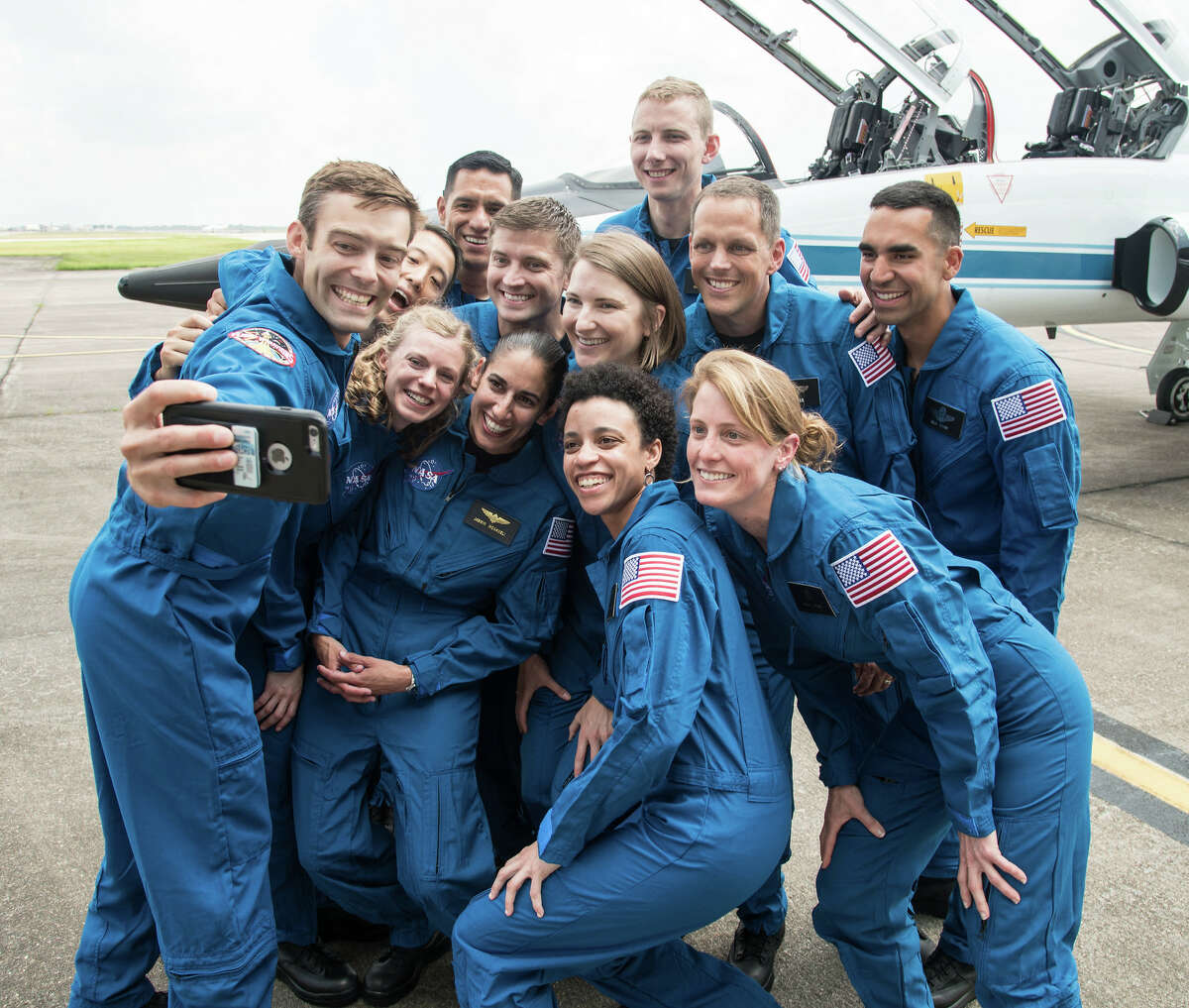 (June 6, 2017) --- NASA's 2017 Astronaut Candidate Class stopped for a group photo while getting fitted for flight suits at Ellington Airport near NASA's Johnson Space Center in Houston, Texas. >>SEE: Historical photos show the women who built NASA (2019)