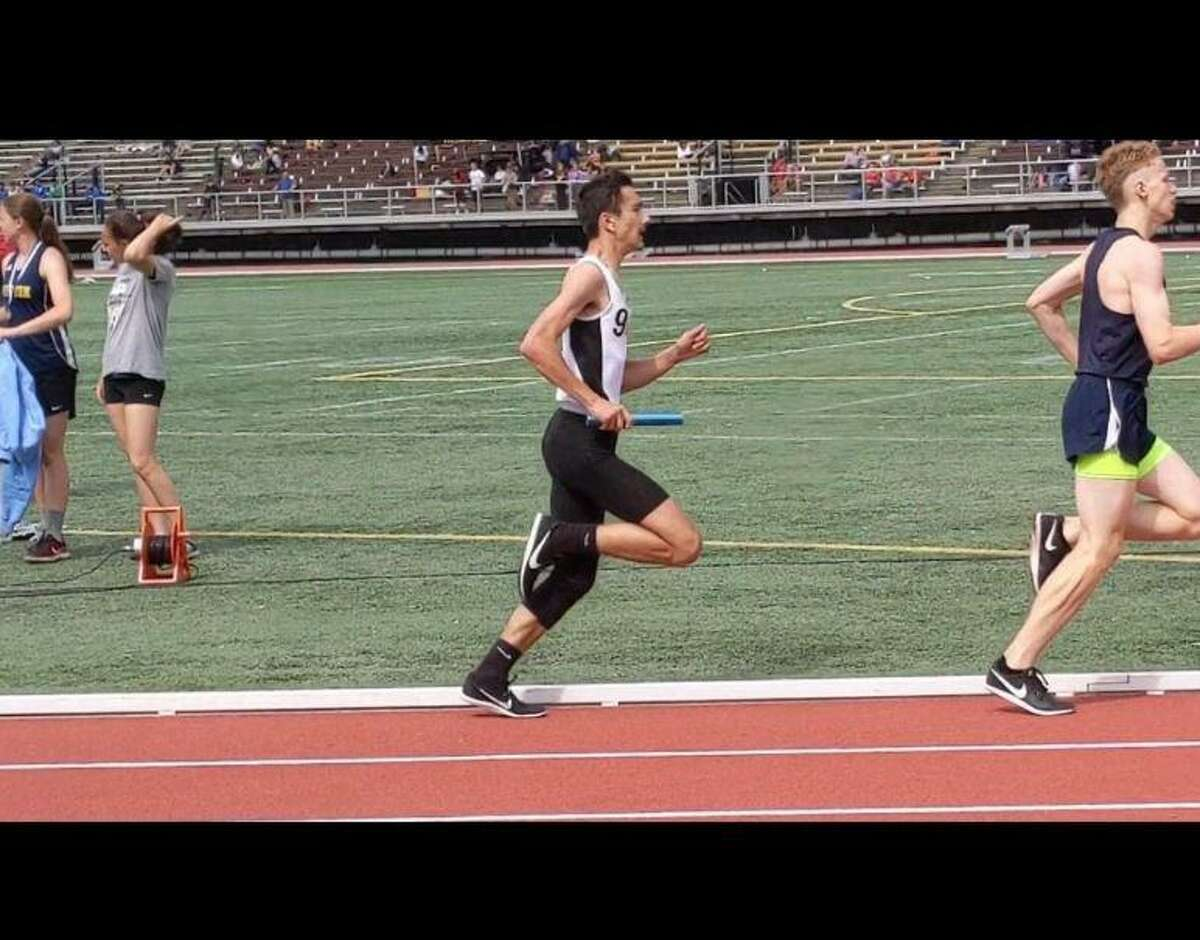 Samuel Kocurek running in the 4x800 at the outdoor track LL conference meet when a member of the Shelton High squad.