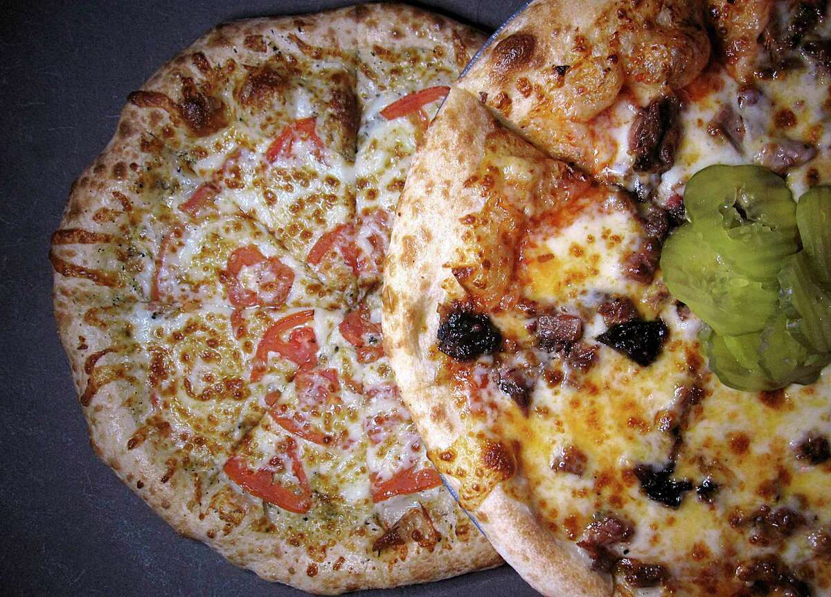 House specialties include white pizza (olive oil, mozzarella, tomatoes, Italian herbs) and a barbecue pizza (brisket, cheese, barbecue sauce) at Big Lou's Pizza.