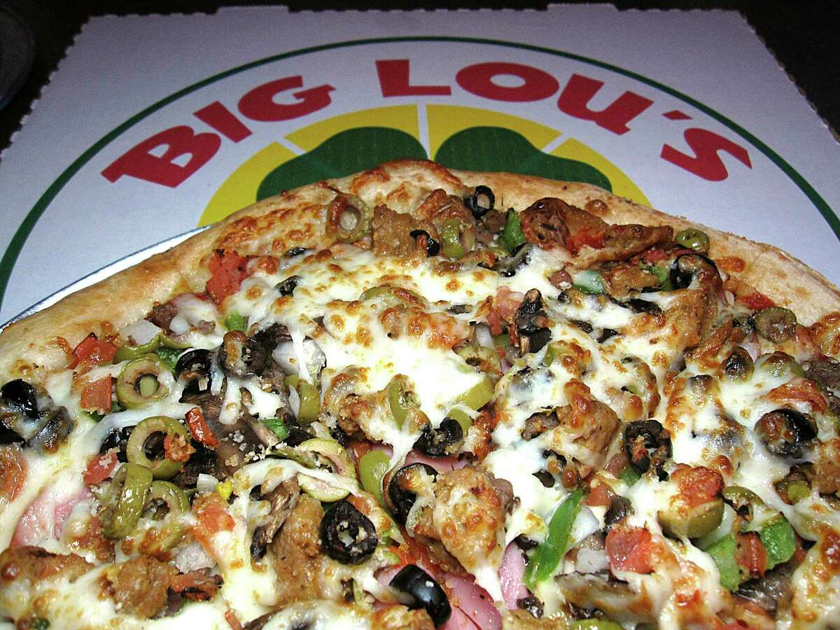 Popular San Antonio pizza joint Big Lou's is celebrating its 20th anniversary this week, offering its customers affordable specials and free delivery options.