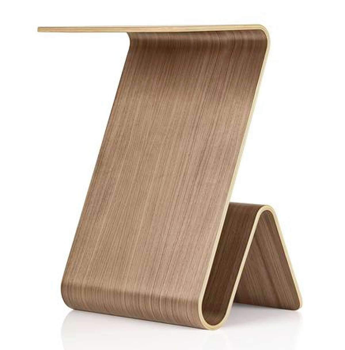 Made of durable molded plywood, the Cobra Table's unique form provides a higher table surface for working at sofa height, while also providing storage on its backside.