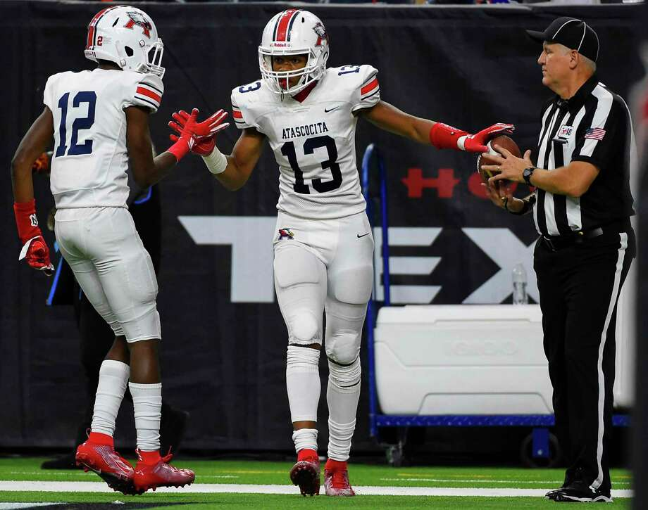 Atascocita wide receiver Landed King (13) celebrates his touchdown with Keith Wheeler during the second half of a high school football playoff game against Dickinson, Saturday, Nov. 23, 2019, in Houston. Photo: Eric Christian Smith / Contributor / Houston Chronicle