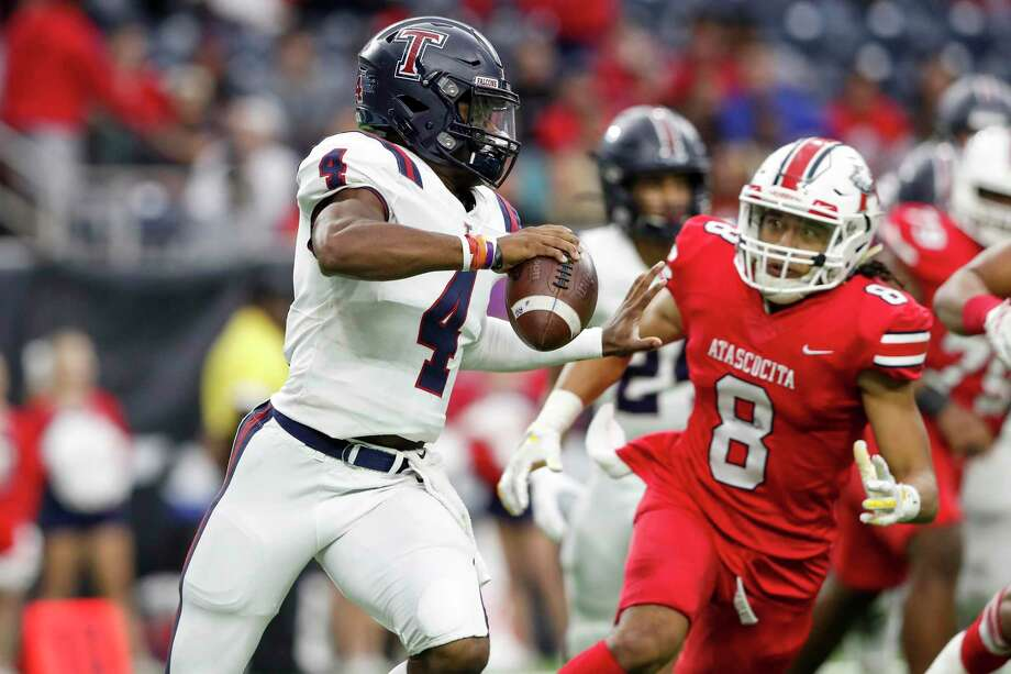 Tompkins Falcons quarterback Jalen Milroe (4) scrambles out of the pocket under pressure by Atascocita Eagles outside linebacker David Tuihalangingie (8) during the first half of the high school football playoff game between the Tompkins Falcons and the Atascocita Eagles at NRG Stadium in Houston, TX on Saturday, November 30, 2019. The Eagles lead the Falcons 35-3 at halftime. Photo: Tim Warner, Houston Chronicle / Contributor / ©Houston Chronicle
