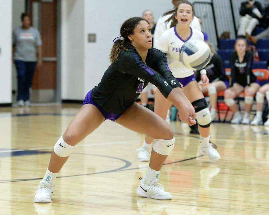 Alexis Dacosta (8) of Fulshear digs for a ball during the second set of a Class 4A Region IV Quarterfinal volleyball playoff match between the Fulshear Chargers and the Bellville Brahamanettes on Tuesday, November 12, 2019 at Bridgeland HS, Cypress, TX. Photo: Craig Moseley, Staff / Staff Photographer / ©2019 Houston Chronicle
