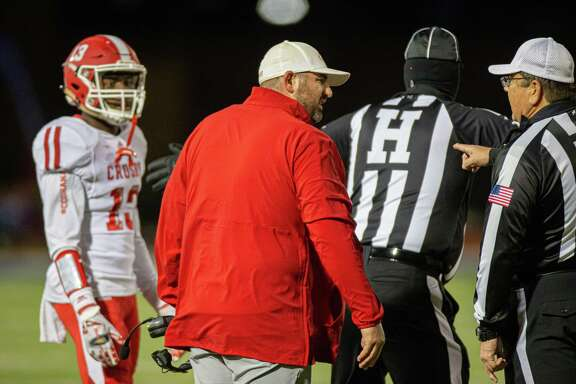 Crosby Cougars head coach Jerry Prieto talking to the sideline official during the second half of action between the Barbers Hill Eagles and the Crosby Cougars during an UIL 5A high school football game at the Barbers Hill Eagle Stadium, Friday, October 25, 2019, in Rosenberg. Barbers Hill Eagle defeated Crosby Cougars 28-7 (Juan DeLeon/Contributor)