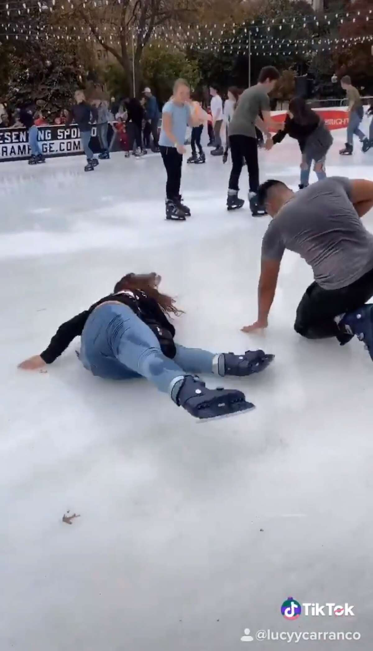 Lucy Carranco tweeted a video on Friday that shows San Antonio ice skaters falling more than once while at the outdoor ice skating rink at Travis Park.