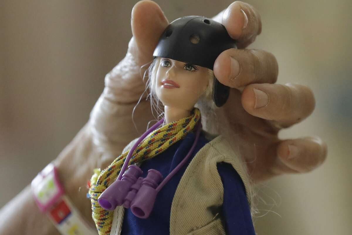 """This Dec. 3, 2019, photo taken on the University of Utah campus in Salt Lake City shows one of the """"treetop Barbies"""" ecologist Nalini Nadkarni created outfitted with miniature versions of her own gear. Fifteen years after she began making the dolls, Mattel asked her to consult on a new line of Barbies with careers in science and conservation. (AP Photo/Rick Bowmer)"""