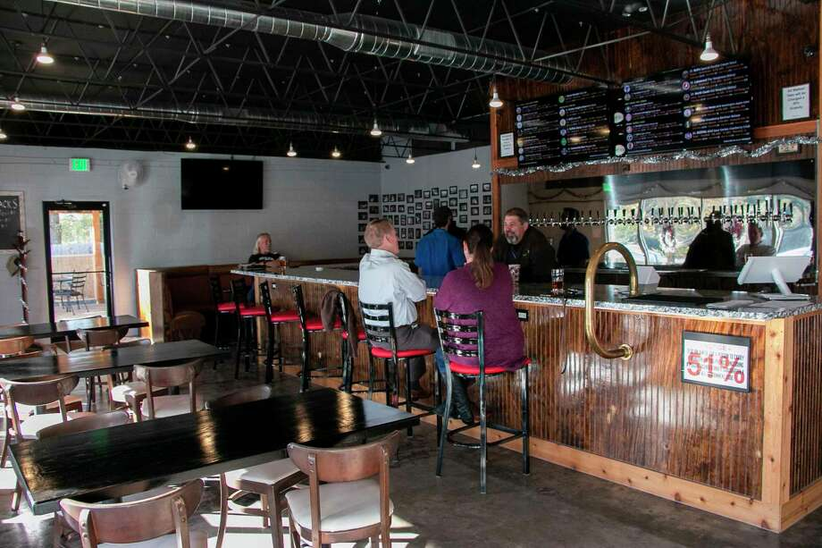 The Cove on Hamblen Road offers a variety of craft beers from across the country and wines from around the world, with reasonable prices and a dog friendly patio. Photo: Savannah Mehrtens/Staff Photo / Savannah Mehrtens/Staff Photo