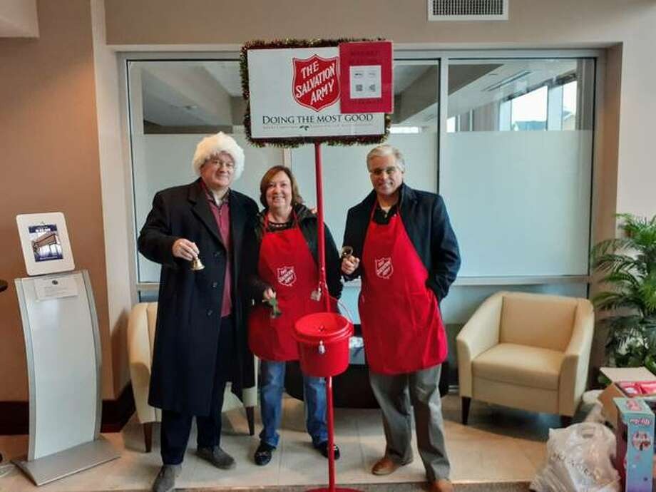 State Rep. Monica Bristow, D-Alton, center, is joined by John Simmons and Alton Mayor Brant Walker in bell-ringing this holiday season for the Salvation Army.