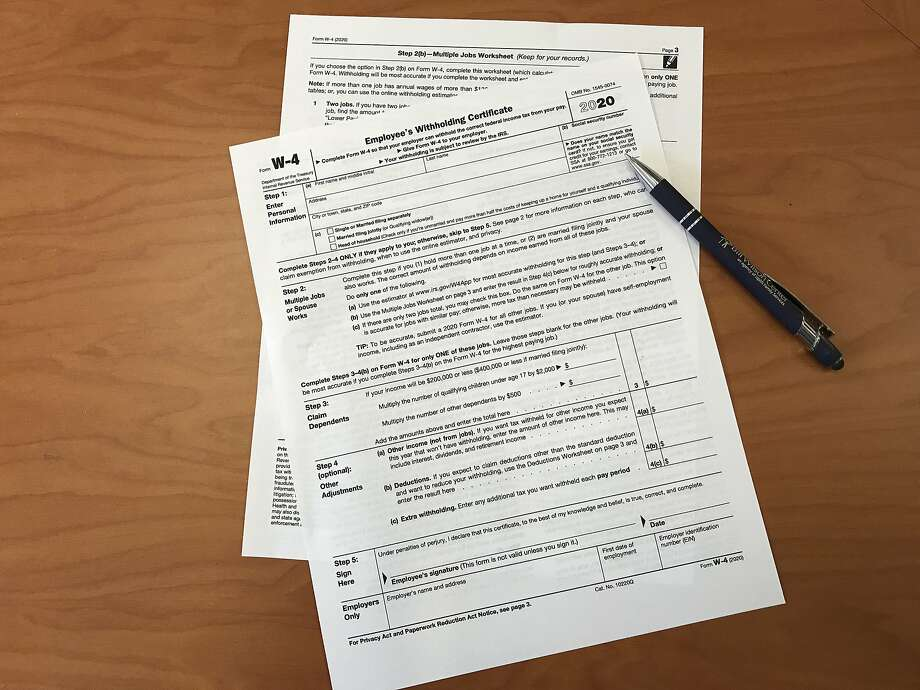 Employees who start a new job or change their federal tax withholding will face an all-new W-4 form in 2020. Photo: Kathleen Pender / The Chronicle