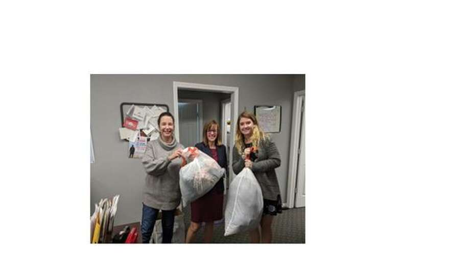 State Rep. Katie Stuart, D-Edwardsville, and saff members gather donations of winter clothing for Making a Difference in Collinsville.