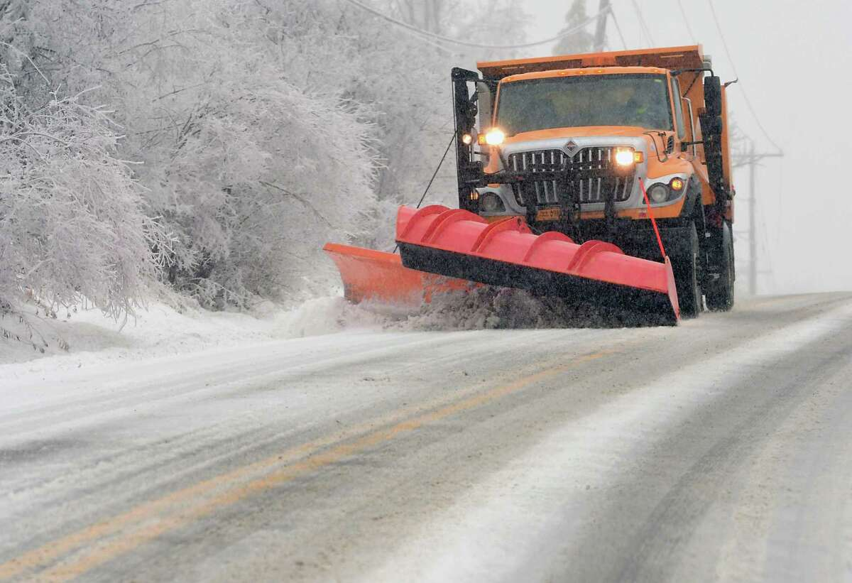 A snowplow clears and salts Berne-Altamont Rd. as an ice storm turns into snow in the hill towns on Monday, Dec. 30, 2019 in Altamont, N.Y. (Lori Van Buren/Times Union)