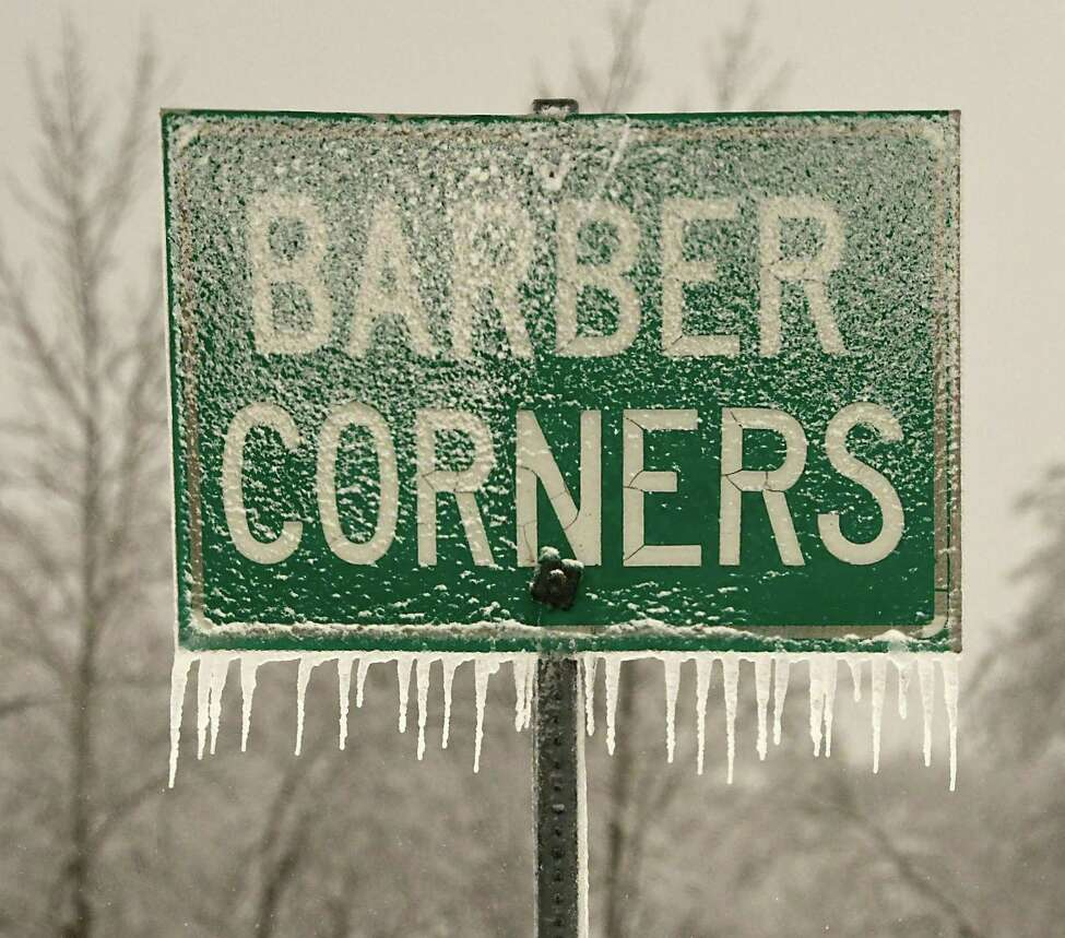 A sign is covered in ice and snow in the hill towns on Monday, Dec. 30, 2019 in Altamont, N.Y. (Lori Van Buren/Times Union)