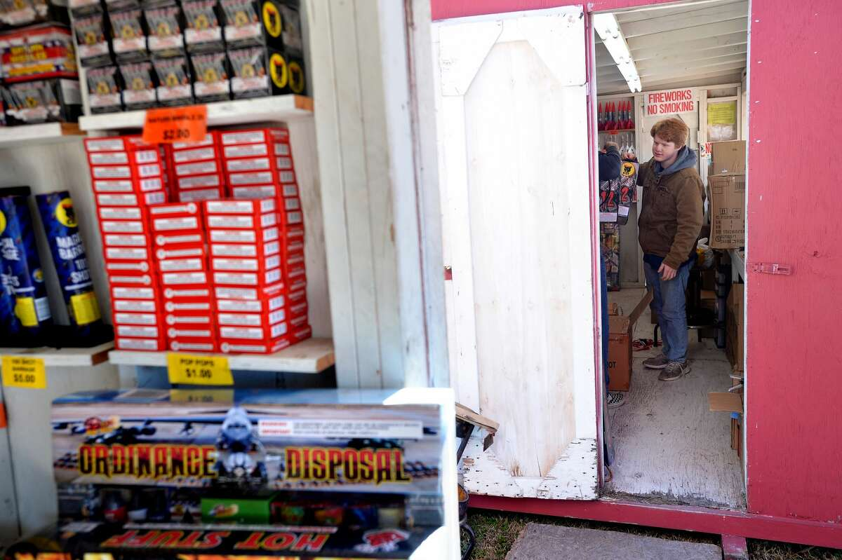"Bryce Butler grabs a box of Diablo 12 fireworks as he and co-workers restock the shelves at the fireworks stand run by Ramirez Carpet & Tile on U.S. 90.It's the second biggest time of the year for fireworks vendors as New Year's celebrants look to ring in the new year not with a bell but a boom. This year's top sellers are the ""Snow Cone"" and ""Diablo 12"" (which is available again this year). The stand will be open until midnight Wednesday morning for last-minute fireworks shoppers on New Year's Eve. Photo taken Monday, December 30, 2019 Kim Brent/The Enterprise"