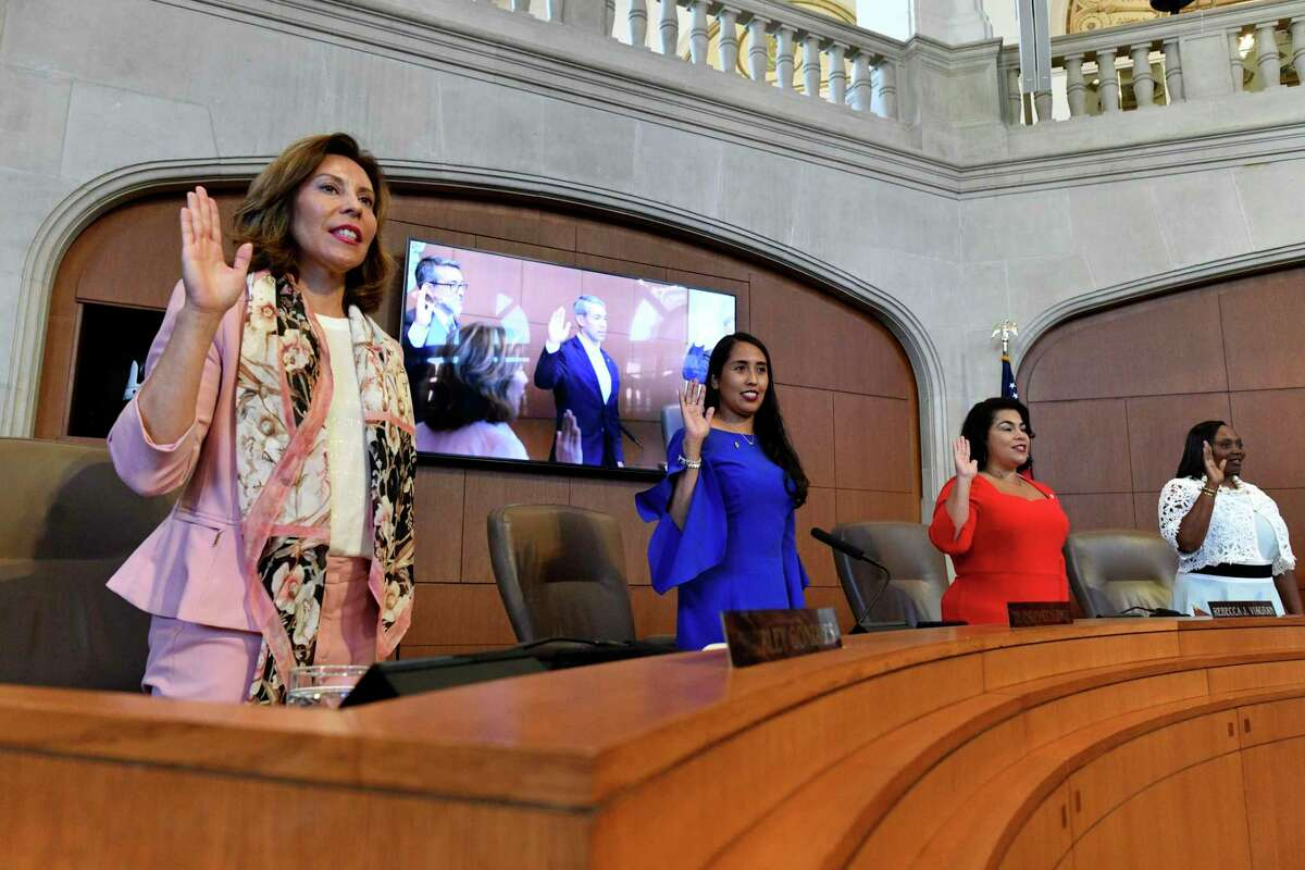 Four of San Antonio City Councils female members; Shirley Gonzales, left, Adriana Rocha Garcia, Rebecca Viagran and Jada Andrews-Sullivan take the oath during an inauguration ceremony for members of San Antonio's new City Council on Wednesday, June 19, 2019. Eight incumbents returned, and three new members - Andrews-Sullivan, Adriana Rocha Garcia and Melissa Cabello Havrda - help form the second female-majority City Council in San Antonio's history.