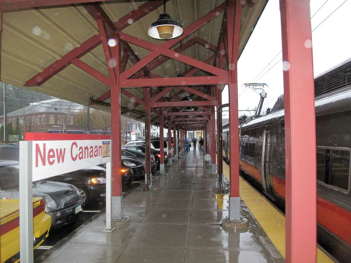 The New Canaan Train Station has a train in it on a rainy day. Trains on the New Canaan Branch train line are now operating on, or close to schedule Monday, April 13, 2020, after earlier power issues, and late arriving equipment delayed them up to 20 minutes, and then five to 10 minutes.